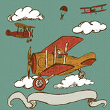 Airplanes  with banner. Hand drawn doodle illustration of vintage airplanes  with banner Stock Photo
