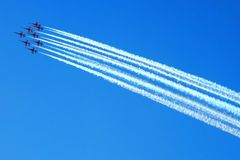 Airplanes on the blue sky Stock Photos
