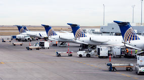 Airplanes boarding and loading cargo Royalty Free Stock Photo