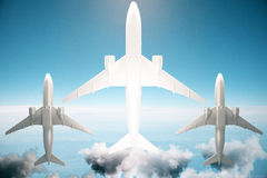 Airplanes bottom view. Bottom view of three airplanes on blue sky background with sunlight. 3D Rendering Stock Photography