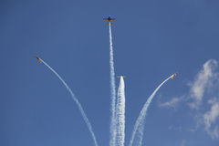 Airplanes breacking formation Stock Image