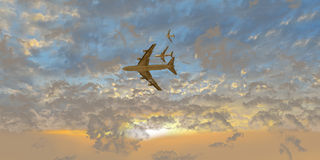 Airplanes Between clouds at sunset Royalty Free Stock Photo