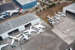 Airplanes docked at the airport, aerial view.  stock images