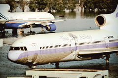 Airplanes drown in the water Stock Images