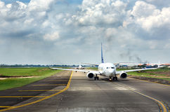 Airplanes going to the runway to take off at Soekarno-Hatta International Airport Stock Photos