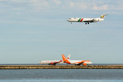 Airplanes landing and departing Stock Photos