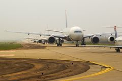 Airplanes in Line. Airplanes waiting in line to takeoff at a major airport stock photo