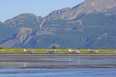 Airplanes Lined up on a Remote Shore Stock Photography