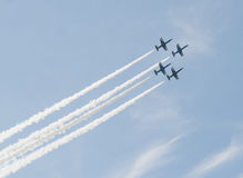 Airplanes making aerobatic manoeuvres Stock Images