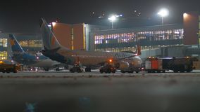 Airplanes parked at Terminal D of Sheremetyevo Airport, night view. Moscow, Russia - November 29, 2018: Night winter view of Sheremetyevo Airport. Airplanes of stock video