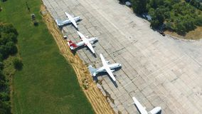 Airplanes are in the parking lot in the open. Museum exhibits aircraft. Aerial footage. 4k stock video