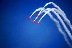 Airplanes performing stunts during airshow royalty free stock images