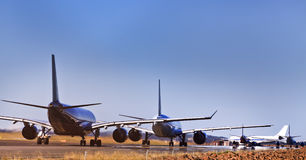 Airplanes 5 runway ground Royalty Free Stock Photos