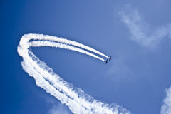 Airplanes show. Two airplanes flying in Airshow Royalty Free Stock Photo