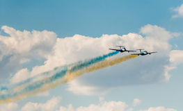 Airplanes in the sky with colorful smoke of Stock Photos