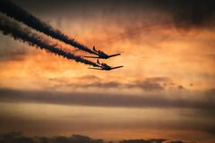 Airplanes in sky with smoke trails Stock Images