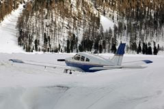 Airplanes in the snow covered landscape and mountains in the alps switzerland.  royalty free stock photo