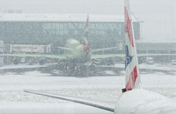 Airplanes at snowstorm Royalty Free Stock Photography