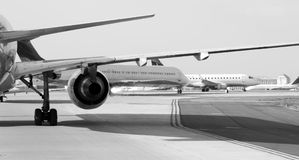Airplanes Taxiing. Black and white image of airliners taxiing across an airport stock photography