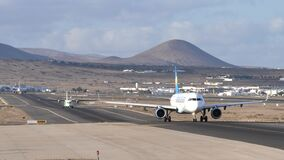Airplanes taxiing on the runway on the Lanzarote airport