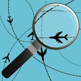 Airplanes on their destination routes with magnifying glass Stock Photo