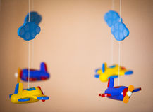Airplanes toys made of wood. Four wooden airplanes toys hanging Royalty Free Stock Image