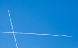 Airplanes trails crossing Stock Photography