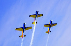 Airplanes trio. Teamwork formation at airshow royalty free stock images