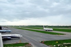 The airplanes of various international airlines on the runway of Pulkovo airport in Saint-Petersburg, Russia Royalty Free Stock Image