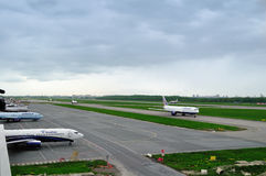 The airplanes of various international airlines on the runway of Pulkovo airport in Saint-Petersburg, Russia Stock Image