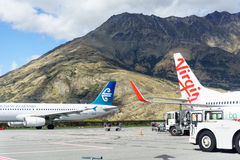 Airplanes waiting take-off. Royalty Free Stock Images