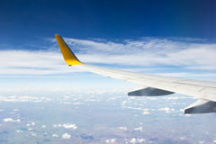 Airplanes wing from window airplane view. Royalty Free Stock Images