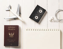AirplaneTraveler Items alignment on top with copy space on a Book Stock Images