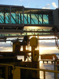 Airport 038. A view at Gangways at sunrise Stock Photos