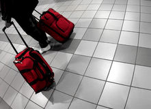 Airport. Man with red bags at the airport royalty free stock photo