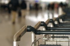 Airport. Row of trolleys in an airport stock images