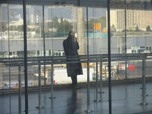 Airport. Alone figure inside in airport Royalty Free Stock Image