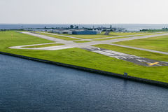 Airport. A small airport in the middle of the ocean with airplanes Stock Images