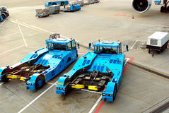Airport. Two airport vehicles at Amsterdam airport (Shiphol Stock Photography