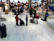Airport action. Travelers moving through an airport stock image
