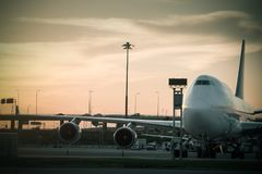 Airport airliner at  with control tower. Airport airliner at dusk departure with control tower Royalty Free Stock Photos