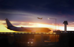 Airport airliner at dusk. Departure with control tower Stock Images