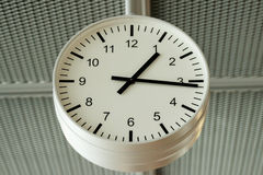 Airport analog clock. Checking time on an airport analog clock Stock Photography
