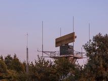Airport antenna hidden in bush Stock Image