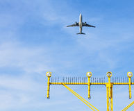 Airport approach landing direction light with airplane Royalty Free Stock Photo