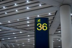 Airport arrival area baggage claim number sign board. In departure area Stock Images