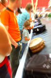 Airport arrival baggage blurred.  Stock Photo
