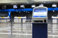 Airport Auto check-in machine out of service. An auto check-in machine out of service at the check-in  counters area inside a Greek Airport Royalty Free Stock Photo