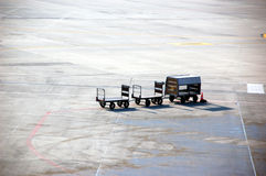 Airport baggage carrier Royalty Free Stock Photo