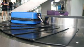 Airport baggage claim with luggage spinning around conveyor royalty free stock photography